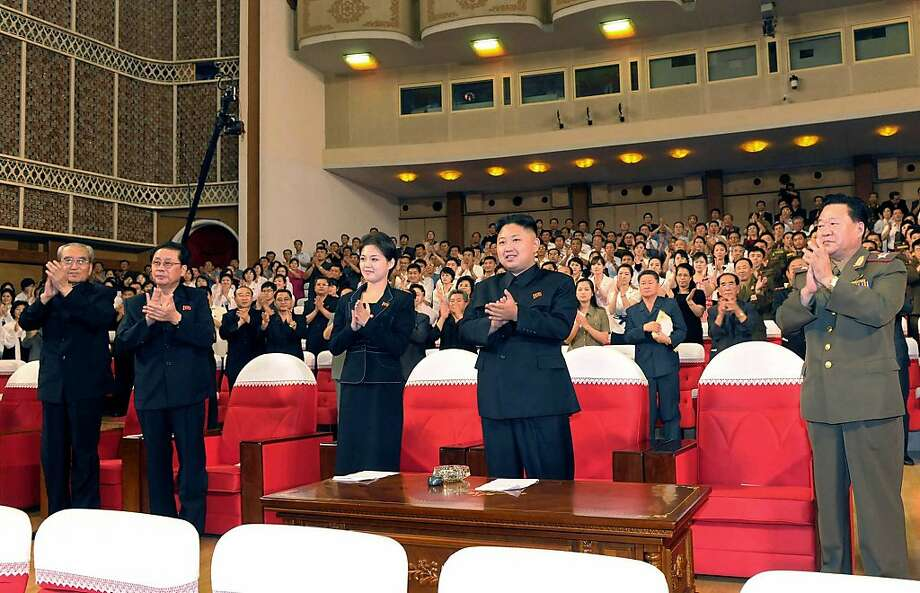 In this photo released by the Korean Central News Agency (KCNA) and distributed in Tokyo by the Korea News Service on Monday, July 9, 2012, North Korean leader Kim Jong Un, center right, and a woman clap with others as they watch performance by North Korea's new Moranbong band in Pyongyang, North Korea, Friday, July 6, 2012. The source did not identify the woman but South Korean media speculated that she could be Kim's younger sister or wife. (AP Photo/Korean Central News Agency via Korea News Service) JAPAN OUT UNTIL 14 DAYS AFTER THE DAY OF TRANSMISSION Photo: Associated Press