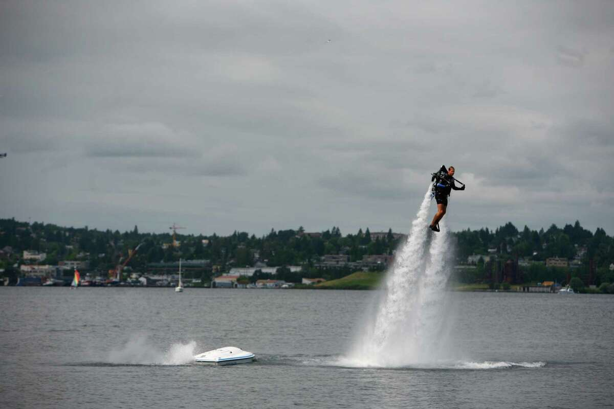 Wes Dawson flies a jet pack during an Air beverage event near Joey Restaurant in the South Lake Union neighborhood of Seattle on Sunday, July 15, 2012. The jet pack is powered by water and used at events to promote the alcoholic beverage Air.