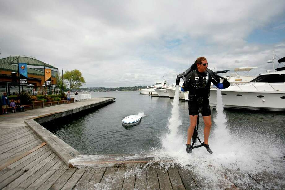 Wes Dawson, the Air pilot, launches the jet pack off of a dock. Photo: Sofia Jaramillo / SEATTLEPI.COM