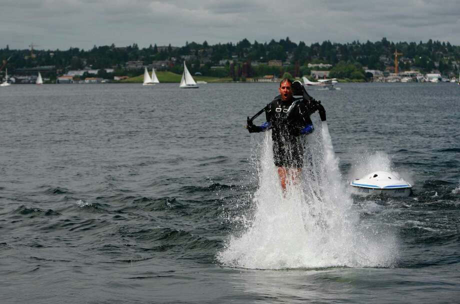 Wes Dawson launches the jet pack out of the water. Photo: Sofia Jaramillo / SEATTLEPI.COM