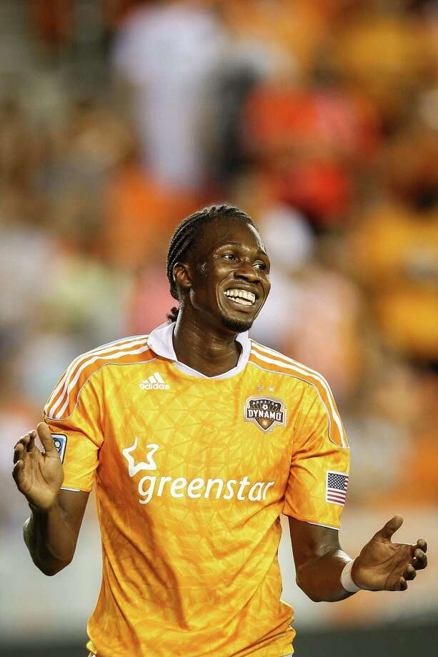 Dynamo midfielder Macoumba Kandji (9) reacts after a play. Photo: Michael Paulsen, Houston Chronicle / © 2012 Houston Chronicle