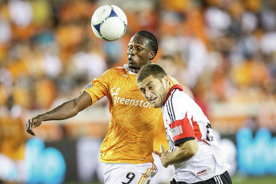 Dynamo midfielder Macoumba Kandji (9) battles for control of the ball with D.C. United's Chris Korb. Photo: Michael Paulsen, Houston Chronicle / © 2012 Houston Chronicle