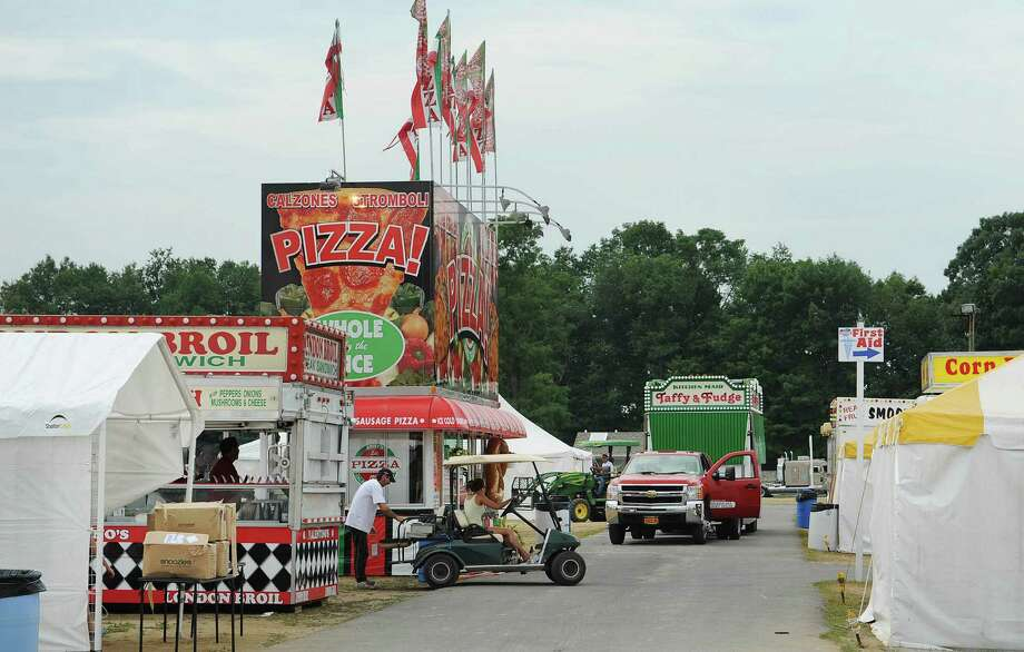 Workers set up in the food vendor section at the  Saratoga County Fair grounds on Sunday, July 15, 2012 in Ballston Spa, NY.  The fair opens on Tuesday.   (Paul Buckowski / Times Union) Photo: Paul Buckowski