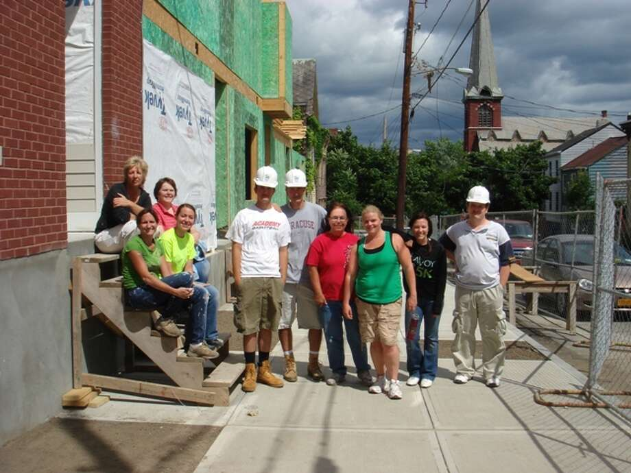 A group of educators from Achievements volunteered with Habitat For Humanity on Alexander Street in Albany. During the last four days of June, Achievements had 40-plus staff members participate over those four days.  (Jim Callister)
