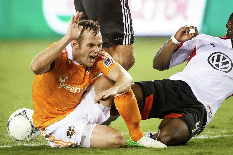 Houston Dynamo midfielder Brad Davis (11) reacts as he slides to the ground during the Houston Dynamo vs. D.C. United MLS soccer game at BBVA Compass Stadium, Sunday, July 15, 2012, in Houston. Photo: Michael Paulsen, Houston Chronicle / © 2012 Houston Chronicle
