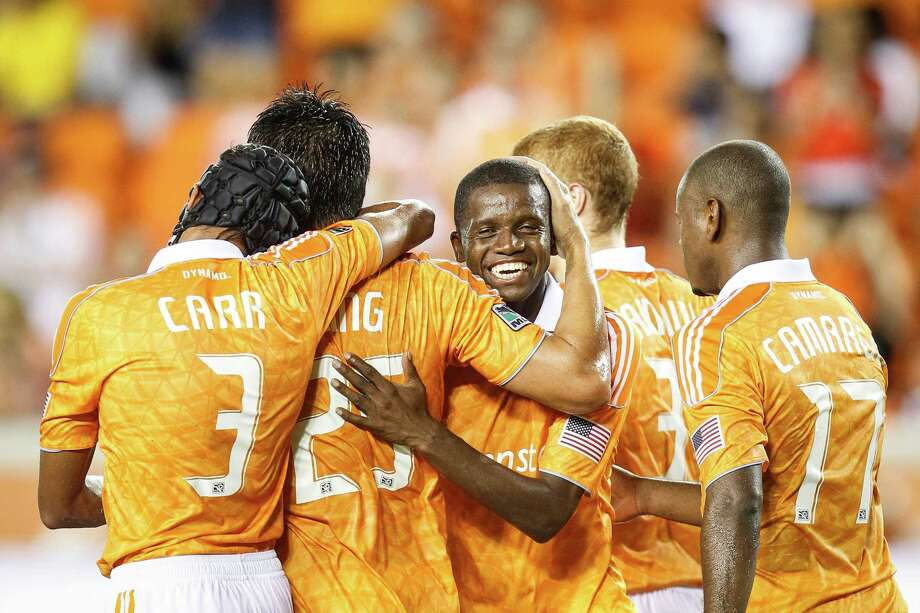 Dynamo forward Brian Ching (25) gets a hug from Dynamo forwards Calen Carr (3) Boniek Garcia (27). Photo: Michael Paulsen, Houston Chronicle / © 2012 Houston Chronicle