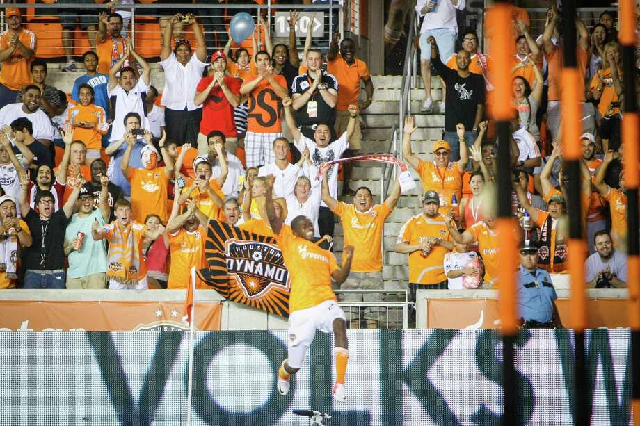 Houston Dynamo fans celebrate along with Houston Dynamo forward Boniek Garcia (27) after Garcia scored a goal to put the Dynamo up 3-0 during the Houston Dynamo vs. D.C. United MLS soccer game at BBVA Compass Stadium, Sunday, July 15, 2012, in Houston. Photo: Michael Paulsen, Houston Chronicle / © 2012 Houston Chronicle