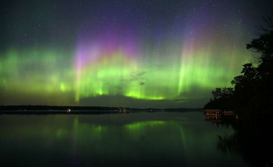 A spectacular display of northern lights filled the sky over Lake Elora in northern Minnesota early Sunday morning on July 15, 2012. A solar storm sparked the show in the skies over the Upper Midwest and could also be active tonight. Photo: Brian Peterson, McClatchy-Tribune News Service