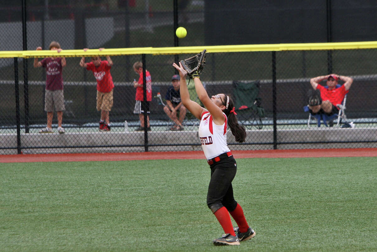 Brittany Romero, 7, makes a catch during the state championship softball game against Mystic on Sunday, June 16, 2012 at Sacred Heart University in Fairfield, Conn.