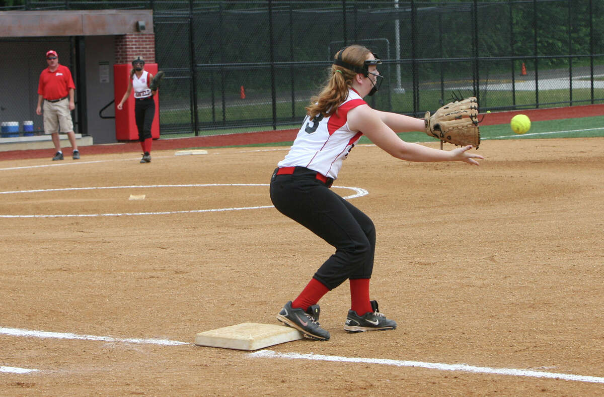 Shannon McCartney, 73, makes a catch during the state championship softball game against Mystic on Sunday, June 16, 2012 at Sacred Heart University in Fairfield, Conn.