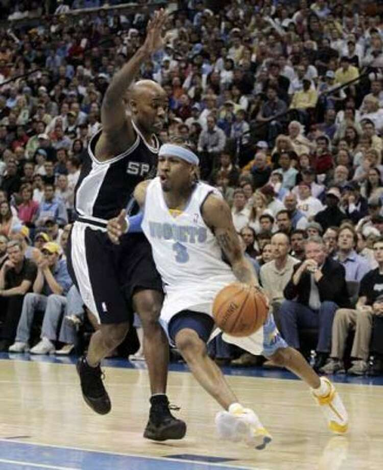 Denver Nuggets guard Allen Iverson (3) drives past Spurs guard Jacque Vaughn (11) during Game 4 of the Western Conference in Denver, April 30, 2007. (Jack Dempsey / Associated Press)