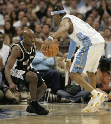 Spurs guard Jacque Vaughn defends against Denver Nuggets guard Allen Iverson during Game 4 of the Western Conference in Denver, April 30, 2007. (William Luther / San Antonio Express-News)
