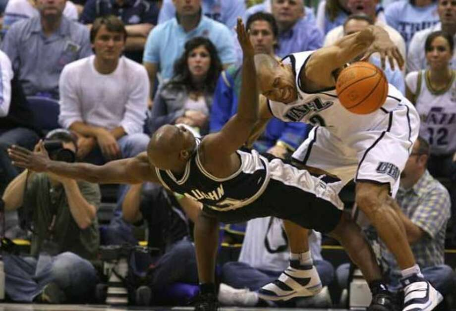 Spurs guard Jacque Vaughn is knocked flat by Utah Jazz guard Derek Fisher, who was called for the foul during Game 4 of the Western Conference Finals in Salt Lake City on May 28, 2007. (Edward A. Ornelas / San Antonio Express-News)