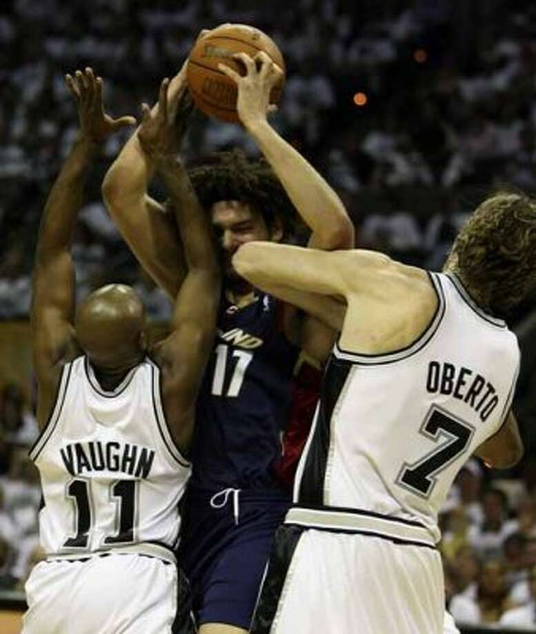 Cleveland Cavaliers forward Anderson Varejao runs into the double team of Spurs guard Jacque Vaughn and forward Fabricio Oberto during Game 1 of the NBA Finals at the AT&T Center on June 7, 2007. (Edward A. Ornelas / San Antonio Express-News)