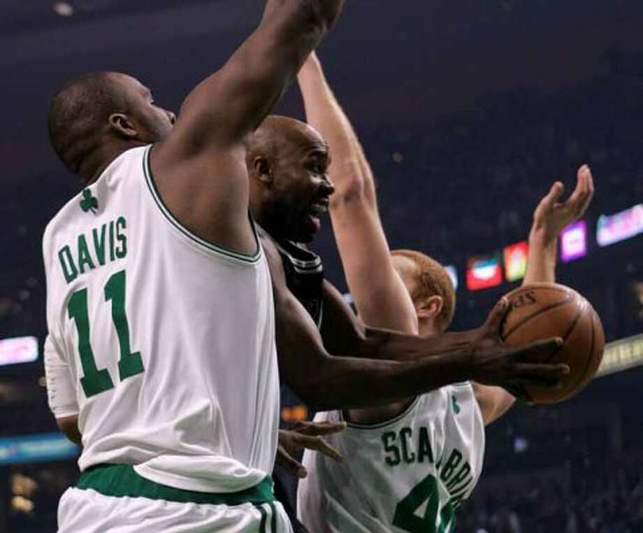 Spurs guard Jacque Vaughn drives between the Boston Celtics' Glen Davis and Brian Scalabrine on Feb. 10, 2008, in Boston. (Michael Dwyer / Associated Press)