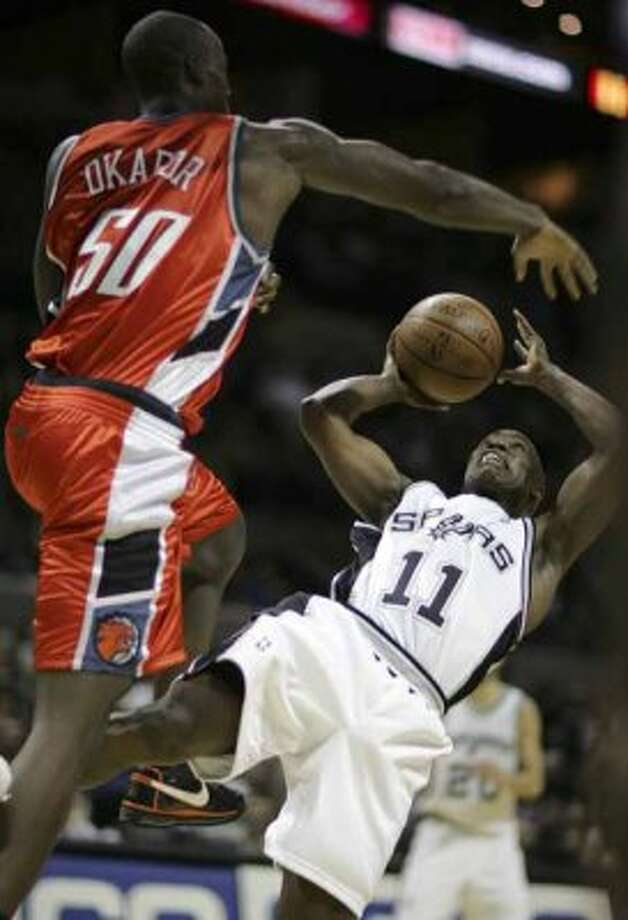 Spurs guard Jacque Vaughn is fouled by the Charlotte Bobcats' Emeka Okafor on Feb. 19, 2008 at the AT&T Center. (Bahram Mark Sobhani / San Antonio Express-News file photo)