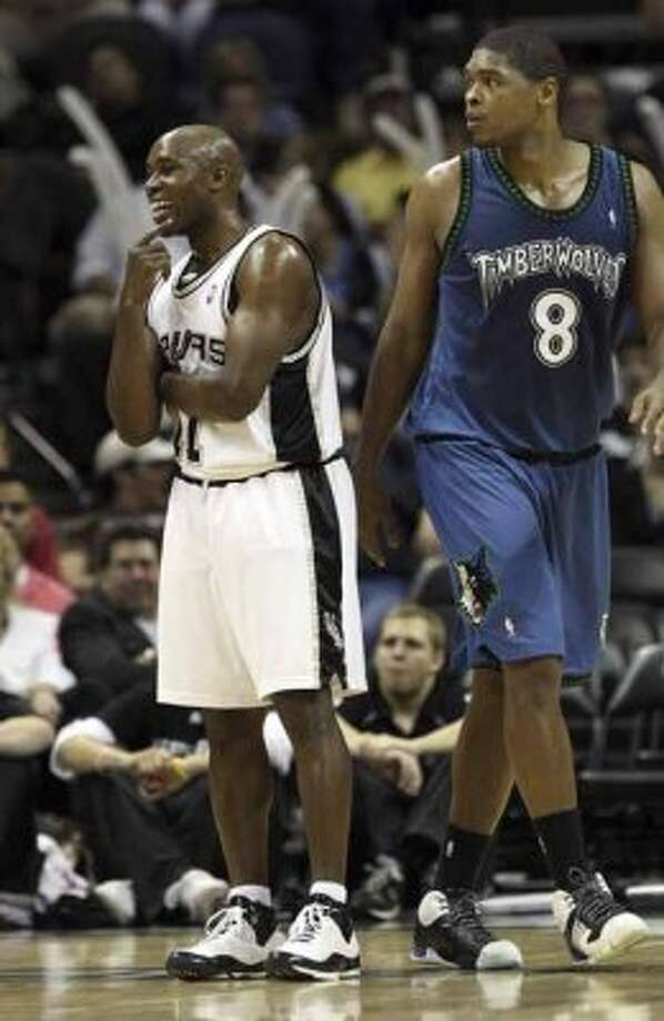 Spurs guard Jacque Vaughn reacts after realizing that a foul called was against the Minnesota Timberwolves and not him on March 28, 2008 at the AT&T Center. (Gloria Ferniz / San Antonio Express-News file photo)