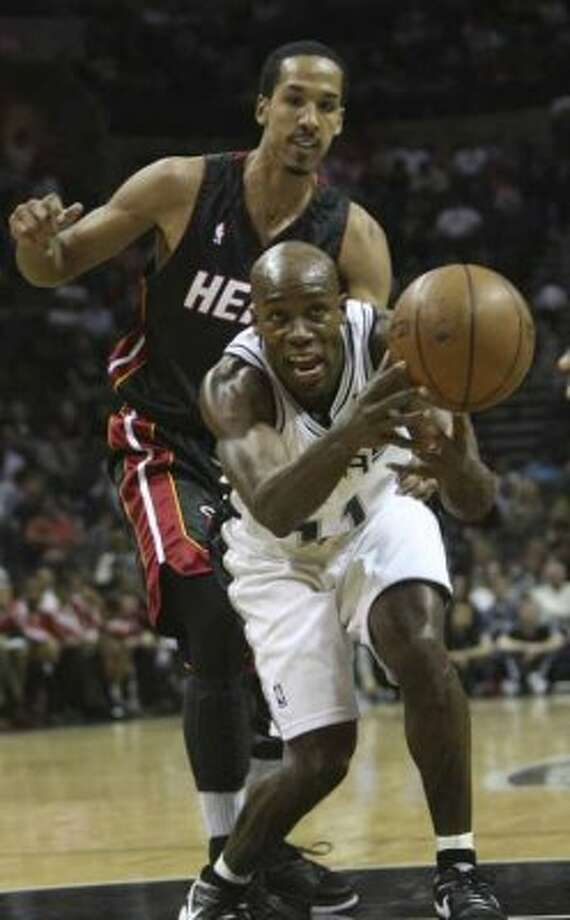 Spurs guard Jacque Vaughn is fouled from behind by the Miami Heat's Shaun Livingston during a preseason game at the AT&T Center on Oct. 23, 2008. (Delcia Lopez / San Antonio Express-News file photo)