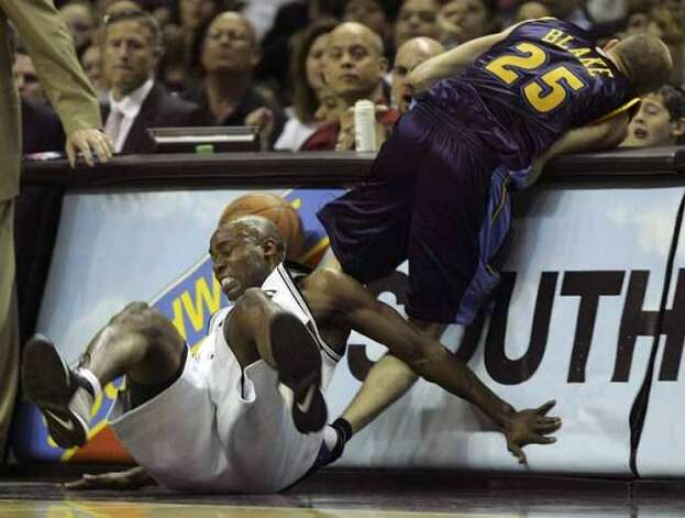 Spurs guard Jacque Vaughn runs into the Denver Nuggets' Steve Blake while attempting to steal the ball during Game 1 of the first round of the Western Conference playoffs at the AT&T Center on April 22, 2007. (Jerry Lara / San Antonio Express-News)