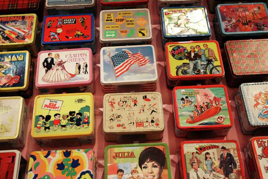 "Lunch boxes are displayed at an exhibit called ""Lunch Hour NYC"" at the New York Public Library in New York, Wednesday, July 11, 2012.  ""Lunch Hour NYC"" transports visitors back in time with sections and artifacts from the library's vast collection on street foods, home lunches, school lunches and the once popular Horn & Hardart Automats. Photo: Seth Wenig, AP / AP"