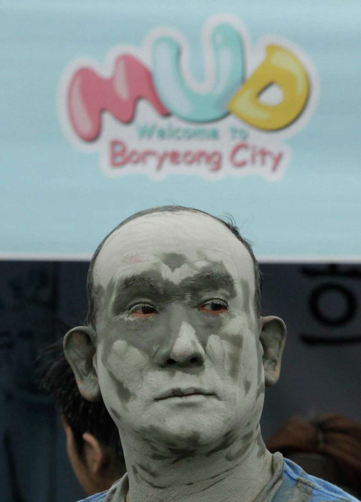 A man with his face covered with mud takes part in the 15th annual mud festival on Daecheon Beach in Boryeong, South Korea, Sunrday, July 15, 2012. The festival features mud wrestling, mud sliding and mud king contest.