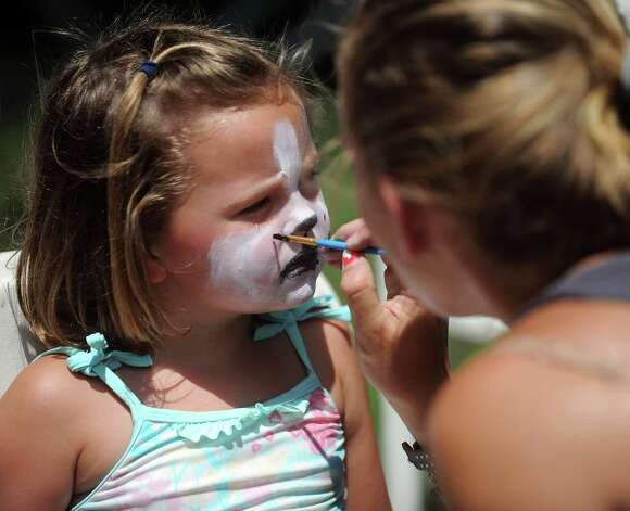 Mimi McDonnell, 4, gets her face painted like a puppy during the 42nd annual River Ramble at Pinkney Park in Rowayton on Saturday, July 14, 2012. Photo: Lindsay Niegelberg / Stamford Advocate