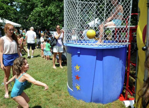 Isabel Alini throws a ball at the dunk tank during the 42nd annual River Ramble at Pinkney Park in Rowayton on Saturday, July 14, 2012. Photo: Lindsay Niegelberg / Stamford Advocate