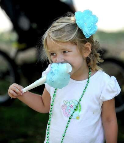 Catherine Hicks, 4, enjoys some blue cotton candy during the 42nd annual River Ramble at Pinkney Park in Rowayton on Saturday, July 14, 2012. Photo: Lindsay Niegelberg / Stamford Advocate