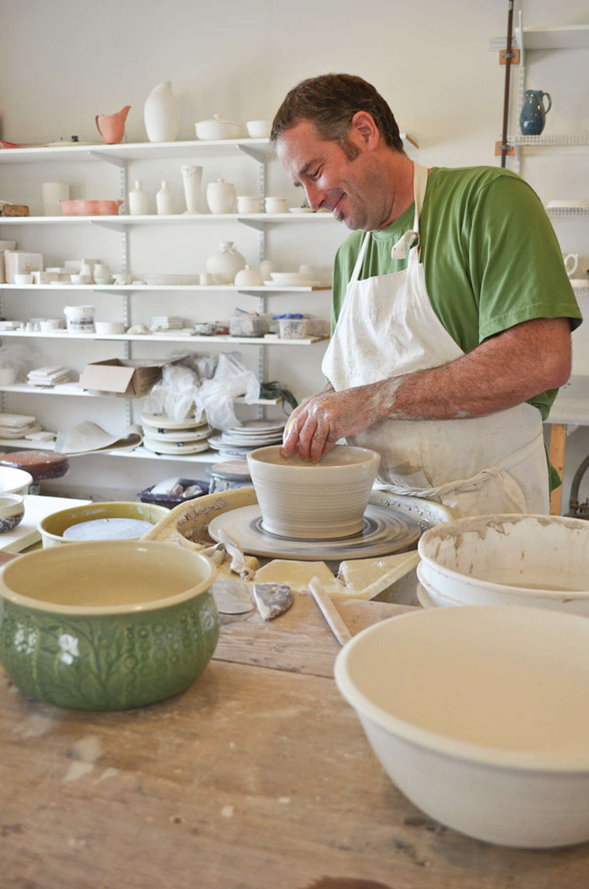 Artisan Doug Klein says texture, pattern, and rhythm are at the heart of both his passions: creating textured clay pottery by day and music by night. Read the full story here.