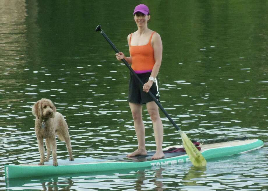 Nature girls--Silver and her pup Sophia on the stand up paddleboard. Photo: Contributed Photo