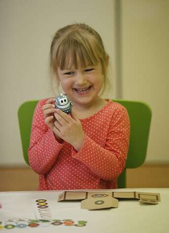 Emily Menelle, age 3, works at the 'My Robot Station' at Kiwi Crate on Thursday, June 21st, 2012 in Mountain View, Calif. Photo: Jill Schneider, The Chronicle