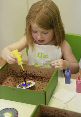 Sophie Housser, age 4, works at the 'Spin Art Station' at Kiwi Crate on Thursday, June 21st, 2012 in Mountain View, Calif. Photo: Jill Schneider, The Chronicle