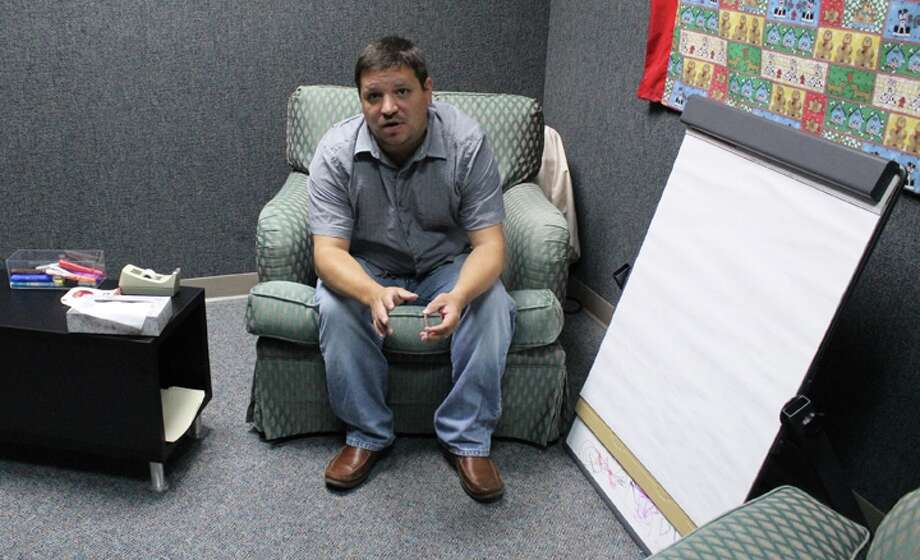 Randy McGibeny, director of programs for ChildSafe, sits in the forensic interview room where children as young as 18 months try to describe their abuse. Photo: Melody C. Mendoza / Northwest Weekly