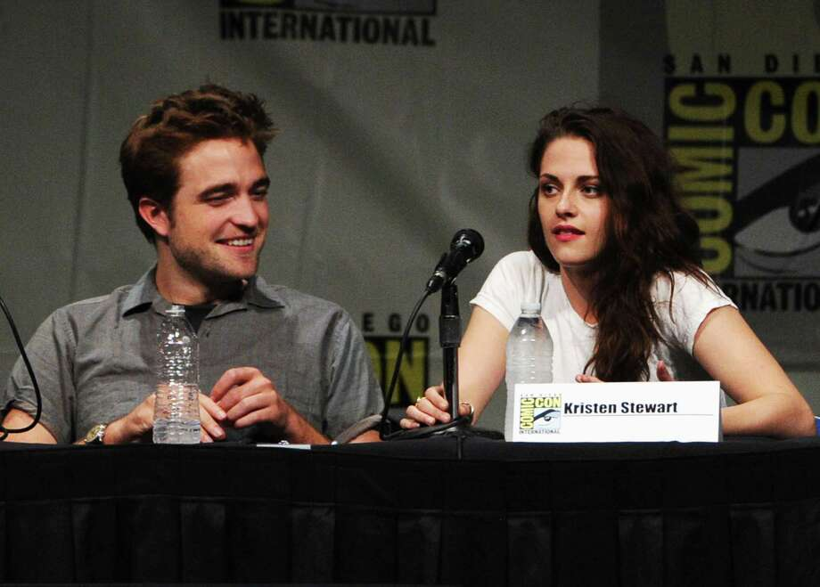"SAN DIEGO, CA - JULY 12:  Actors Robert Pattinson (L) and Kristen Stewart speak at ""The Twilight Saga: Breaking Dawn Part 2"" Panel during Comic-Con International 2012 at San Diego Convention Center on July 12, 2012 in San Diego, California. Photo: Kevin Winter, Getty Images / 2012 Getty Images"