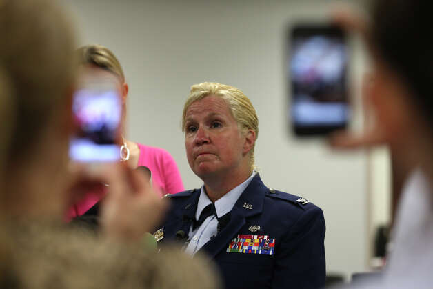 Staff Judge Advocate Col. Polly Kenny, holds a press conference before the start of the court-martial of U.S. Air Force Staff Sgt. Luis A. Walker at Lackland Air Force Base, Monday, July 16, 2012. Walker, a former training officer, is charges with illicit sexual contact with 10 female trainees. He is facing 28 counts including rape and is one of 12 instructors under investigation. Photo: Jerry Lara, San Antonio Express-News / © 2012 San Antonio Express-News