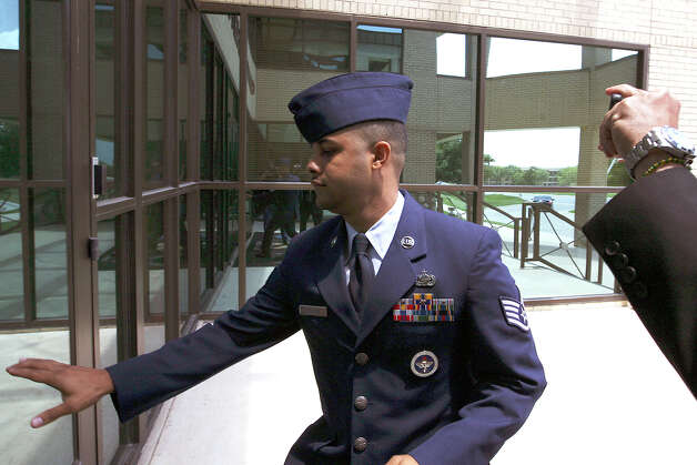 U.S. Air Force Staff Sgt. Luis A. Walker arrives from a lunch break during his court martial at Lackland Air Force Base, Monday, July 16, 2012. Walker, a former training officer, is charges with illicit sexual contact with 10 female trainees. He is facing 28 counts including rape and is one of 12 instructors under investigation. Photo: Jerry Lara, San Antonio Express-News / © 2012 San Antonio Express-News