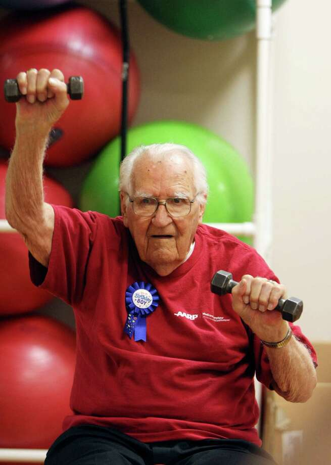 Charlie Kunetka will turn 102 years old on July 17, but he's still exercises three times a week as a member of the Silver Sneakers fitness program. He plans to spend his birthday at the gym where he exercises with fellow seniors. Photo: Helen L. Montoya, SAN ANTONIO EXPRESS-NEWS / ©2012 HELEN MONTOYA PHOTOGRAPHY