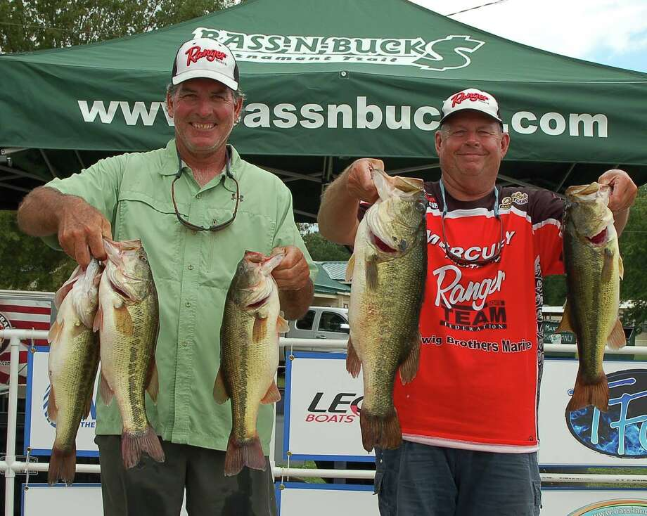 Among the first to weigh in, Martin Elshout and Mark Price's 22.39 lb sack held for a 1st place finish.  They also won Big Bass with their 7.50 lb kicker  photo by Patty Lenderman / Lakecaster