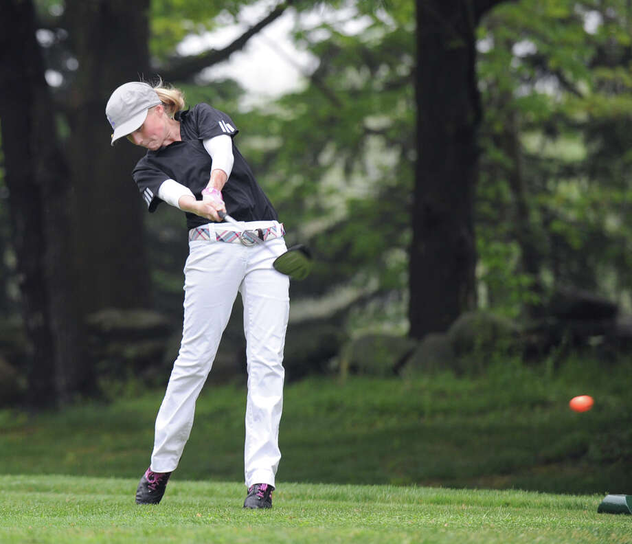 Greenwich High School golfer Alexandra Sazhin hits off the second tee during girls high school golf match between Darien High School and Greenwich High School for a half-hour at the Griffith E. Harris Golf Course in Greenwich, Wednesday afternoon, May 9, 2012. Photo: Bob Luckey / Greenwich Time