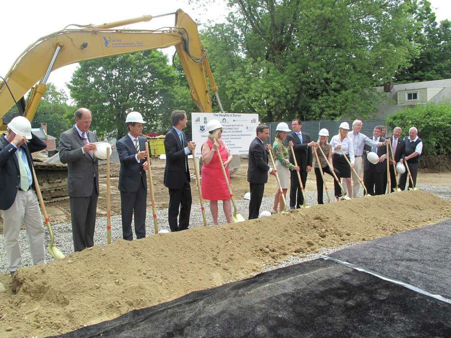 Gov. Dannel Malloy leads state and local Darien officials, as well as some investors in The Heights at Darien affordable housing redevelopment on Allen O'Neill Drive, in the project's ground breaking. In addition to Malloy, Congressman Jim Himes, Sen. Bob Duff and selectmen Jayme Stevenson, Gerald Nielsen and John Lundeen prepare to toss the first piles of dirt that will commence phase 1 of construction on Monday, July 16, 2012. Darien, Conn. Photo: Thomas Michael