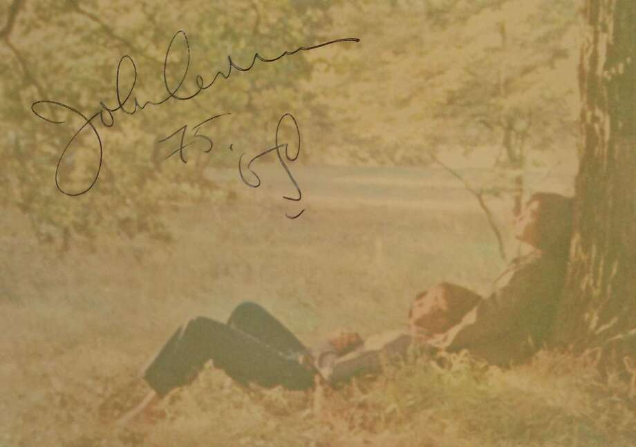 "John Lennon's widow, Yoko Ono, gave Ken Hoffman a framed, autographed copy of ""Plastic Ono Band."" Photo: Ken Hoffman"