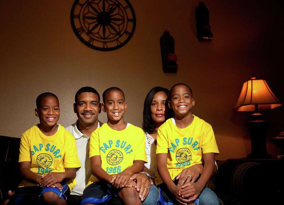 Jeffery McGowen with his surviving sons Jacoby, from left, Jason and Jacob, and his sister, Cynthia Cage. Both McGowen and Cage have donated their bone marrow. The death of McGowen's newborn quadruplet Justin inspired him to become a donor. Photo: Cody Duty / © 2011 Houston Chronicle