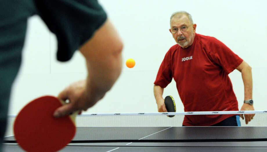 Shalom Lampell, 80, of Brookfield, plays pingpong at Greenknoll YMCA in Brookfield, Friday, July 13, 2012. Photo: Carol Kaliff / The News-Times