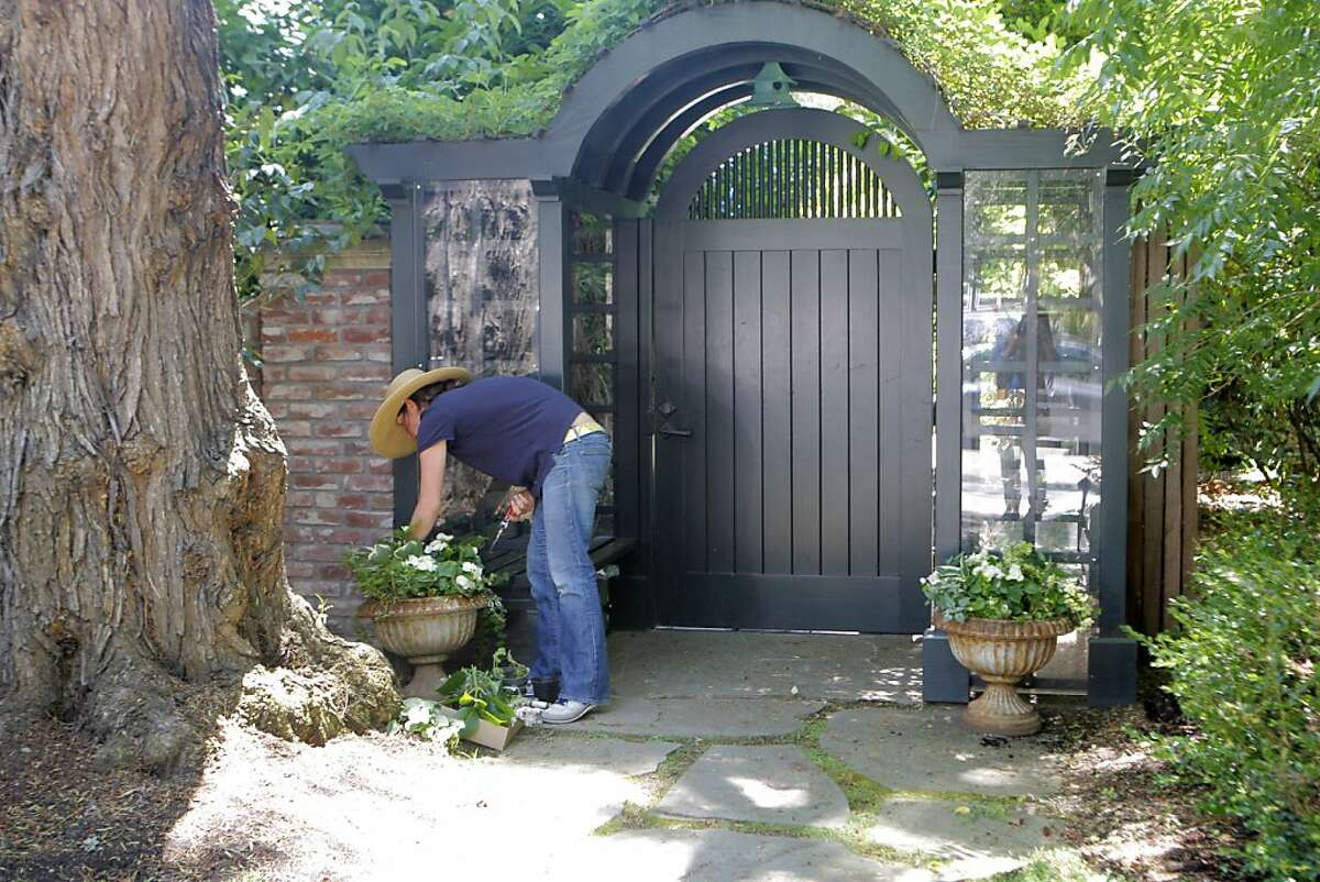 A gardener who did not want to be identified works on the exterior of billionaire Mark Zuckerberg's home in Palo Alto, Calif. on Monday, July 16, 2012.