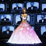 A model wears a creation designed by French fashion designer Frank Sorbier for his Haute Couture Fall-Winter 2013 collection presented in Paris, Wednesday, July 4, 2012. (AP Photo/Thomas Padilla) (AP)