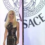 Fashion designer Donatella Versace appears at the end of  her Women's Fall Winter 2013 haute couture fashion collection in Paris, France, Sunday, July 1, 2012. (AP Photo/Jacques Brinon) (AP)