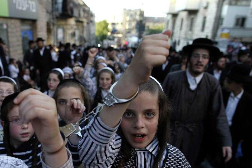 Ultra-Orthodox Jewish children wear handcuffs as they ...