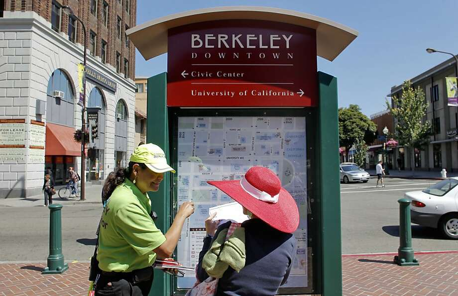 Downtown Business Association Ambassador, Robbi Montoya, informs a visitor along Shattuck Avenue on Wednesday July 11, 2012. Photo: Michael Macor, The Chronicle