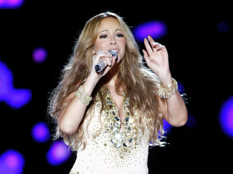 "FILE - This May 26, 2012 file photo shows U.S. Singer Mariah Carey performing on stage during a concert at the Mawazine Festival in Rabat, Morocco. A person familiar with the singing competition series ""American Idol""  negotiations say Carey is being pursued to join the judging panel of the Fox talent competition. The source requested anonymity because of the private nature of negotiations. (AP Photo/Abdeljalil Bounhar, file) Photo: Abdeljalil Bounhar"