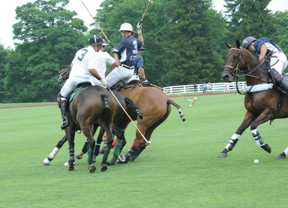 White Birch's # #3Mariano Aquerre against Airstream #3 Michel Dorignac at the Greenwich Polo Club final championship tournament of the East Coast Sunday, July 15, 2012. Photo: Helen Neafsey / Greenwich Time